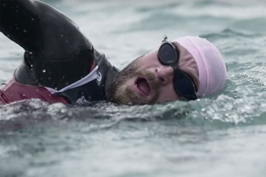 endurance athlete swimming in lake